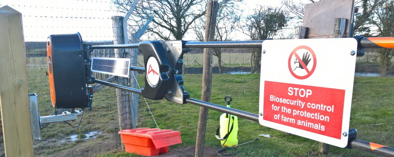 Controlling traffic into a poultry unit. Access using fob or telephone to open barrier